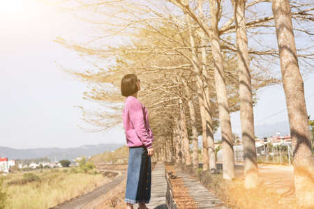 portrait of Asian woman stand in the outside under the tree