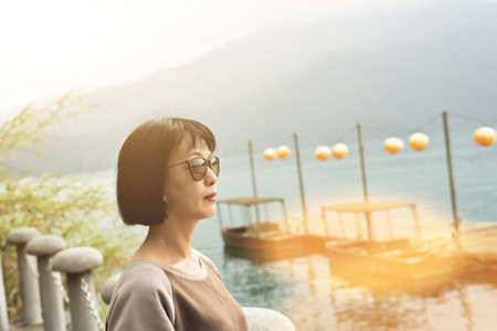 traveling mature Asian woman at Sun Moon Lake, Taiwan Stok Fotoğraf