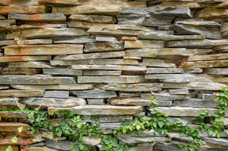 stone wall with green moss background 写真素材 - 130040614