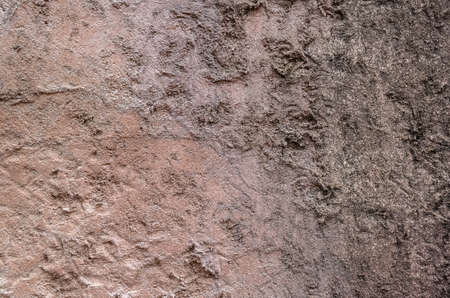 background of rough stone wall in brown color