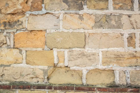 aged yellow brick wall with good texture 写真素材 - 130041073