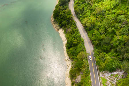 aerial view of a road with trees near the lake in Mingtan Reservoir, Shuili town, Nantou, Taiwan