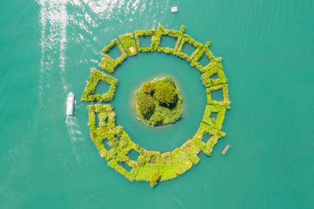 "aerial view of a small island named ""Lalu"" at famous Sun Moon Lake landscape in Nantou, Taiwan"