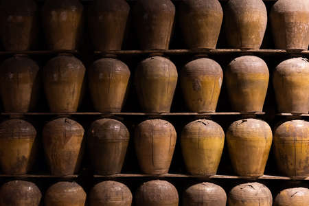 rows of fermented alcoholic beverage in the old pottery at Puli Brewery, Nantou, Taiwan Stock fotó