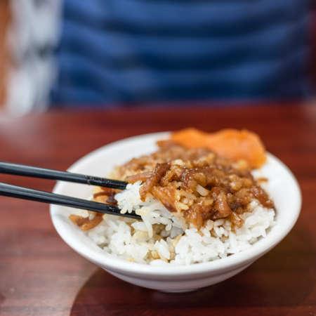 Taiwanese snacks of braised pork on rice on table Reklamní fotografie