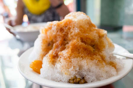 eating shaved ice , famous Taiwanese snacks at Taiwan