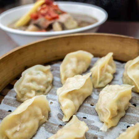 Taiwanese famous snacks of steamed dumplings on table in a restaurant Reklamní fotografie