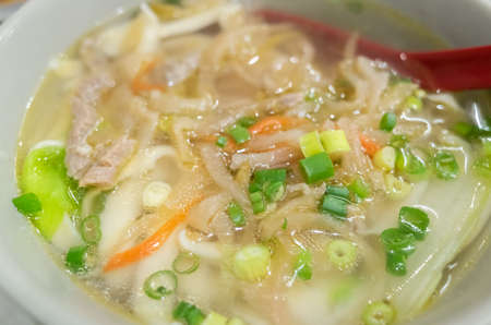 traditional Taiwanese food of pork, pickled mustard green noodles