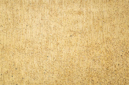 background of rough stone wall in yellow brown color