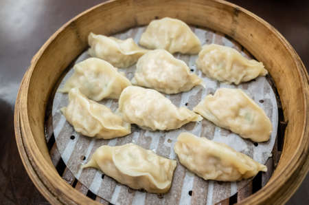 Taiwanese famous snacks of steamed dumplings on table in a restaurant Banco de Imagens
