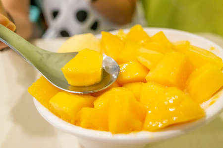 eating mango shaved ice with colorful dessert, famous Taiwanese snacks at Taiwan Standard-Bild
