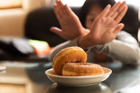 Asian woman reject eat donuts at home