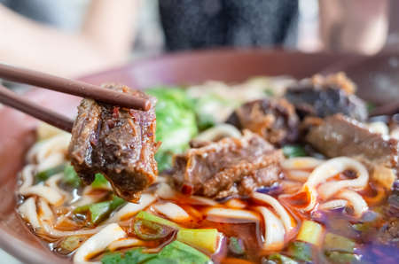 a bowl of hot braised beef noodle soup