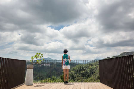 landscape of walking woman at the outdoor in the wooden balcony Standard-Bild