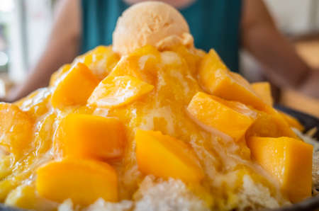 eating mango shaved ice with colorful dessert, famous Taiwanese snacks at Taiwan 写真素材