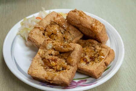 famous Taiwanese snack of stinky tofu on the table