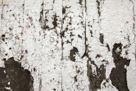 white weathered wall with peeling paint surface and good detail