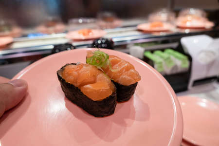 fast sushi on a plate in the restaurant at Taiwan