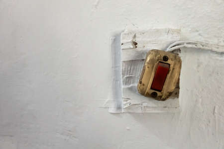 old red button of electric bell or light Stockfoto
