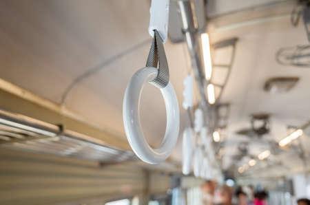 white handle on the ceiling for standing passenger Stockfoto