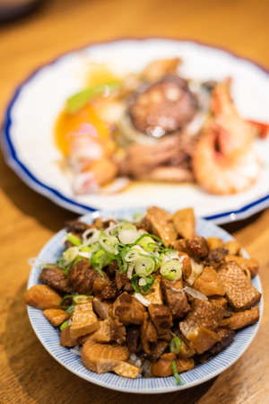 Taiwanese snacks of Chinese seafood pork on rice on table