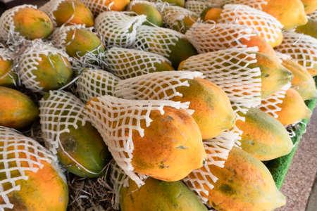 stacks of papaya at the traditional marketplace in Taiwan