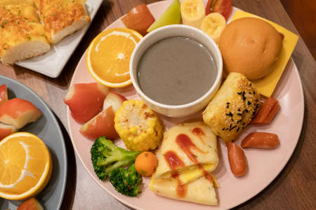 hearty breakfast with bread and fruit on a plate at home
