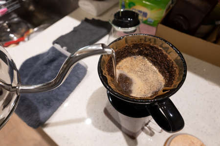 pour-over coffee concept with water on the table Stockfoto