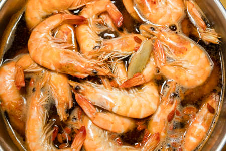 group of shrimps with soup in a pot Stockfoto