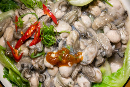 homemade blanched oysters on a plate at home