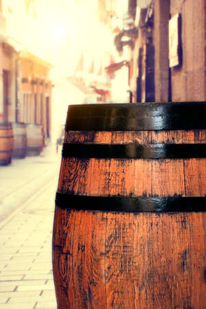Wooden barrel on a street in Logro�o. More barrels in the background. photo