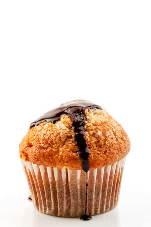 liquid chocolate: Homemade muffin with liquid chocolate on white background.Vertical image