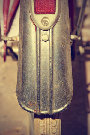 fender: Detail retro bicycle fender. It looks part of the brake and wheel. Vintage style. Vertical image.