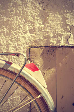 fender: Detail of retro bicycle wheel. It looks part of the rear fender and the brake. Vintage style. Vertical image.