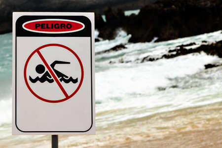 no swimming sign: No Swimming sign on a beach in Cantabria, Spain. Horizontal image. Stock Photo