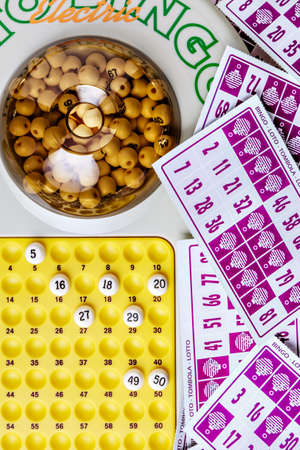 loto: Electronic bingo game with cards to play. Vertical image viewed from above. Stock Photo