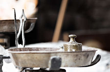 Steelyard  with weights on a traditional craftsman market.Horizontal image. Stock Photo
