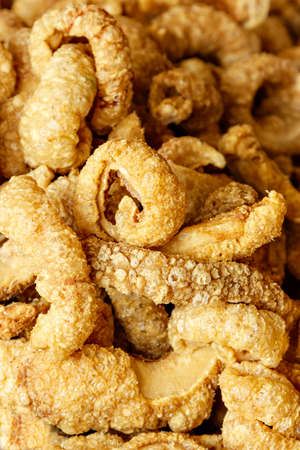 rinds: Pork rinds on a traditional craftsman market.Vertical image.
