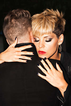 adult  male: Fashionable young romantic couple hugging. Urban fashion photography. Horizontal image.