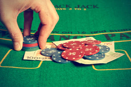 betting: Man betting with poker chips. Horizontal image. Vintage style.