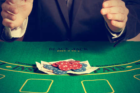 poker player: Winning poker player. Horizontal image. Vintage style. Stock Photo