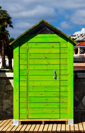 brighton: Beautiful green wooden beach cabin. Vertical image. Stock Photo
