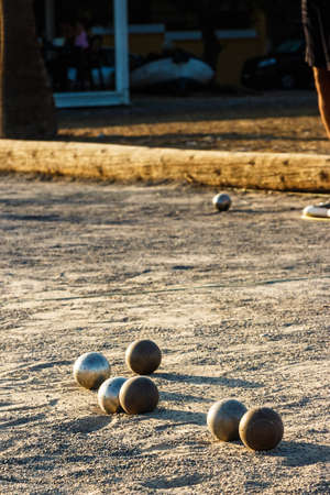 Game of petanque on the ground. Verical image.