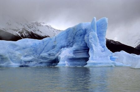 icescape: A bright iceberg in bad weather conditions