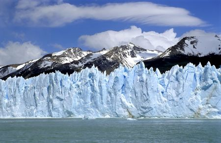 Glacier Perito Moreno with Mountain range Stock Photo