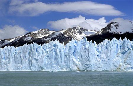 Glacier Perito Moreno with Mountain range Stock Photo