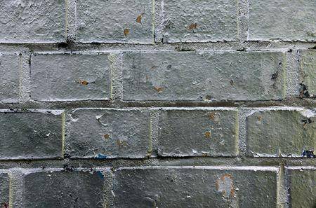 Brick wall with silver Graffiti photo