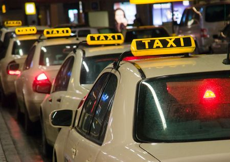 spotlit: Taxis waiting at the airport