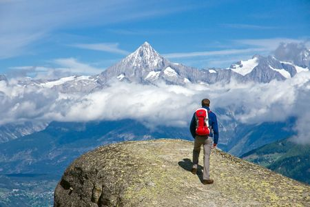 difficult journey: Hiker in the swiss alps