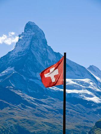 Swiss flag with the Matterhorn Stock Photo - 7783645